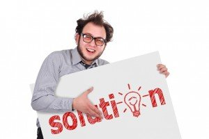 "A guy holding a sign that says ""Solution"""