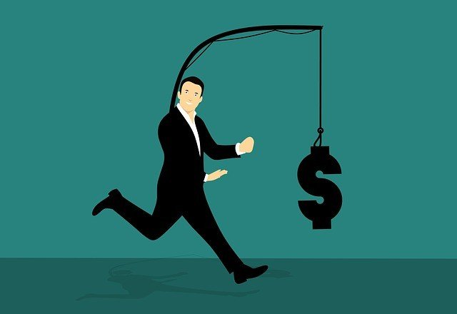 Man chasing money on a string