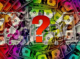 question mark with dollar bills behind it